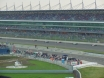 Champs cars racing in front of the grandstand on the opening race Thumbnail